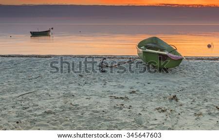 Colorful sunrise at a village of fishermen, Baltic Sea, Latvia - stock photo