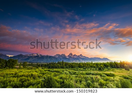 Colorful sunrise at Blacktail Ponds Overlook in the Tetons - stock photo