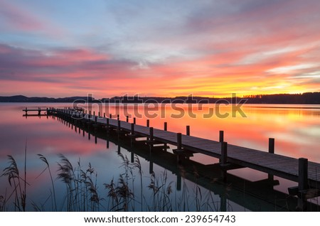 Colorful sunrise at Lake Woerthsee near Munich, Bavaria, Germany - stock photo