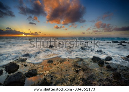 colorful sunrise from Sandy Beach, Oahu, Hawaii, USA - stock photo