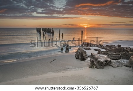 Colorful sunrise near a village of fishermen, where the history of traditional fisheries meets with marvelous scenic seascapes, Baltic Sea, Europe - stock photo