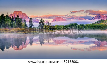 Colorful sunrise on the Snake River in Wyoming - stock photo