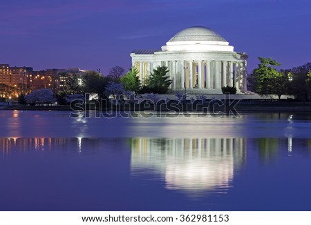 Colorful sunrise over Tidal Basin during cherry blossom festival in Washington DC, USA. Thomas Jefferson Memorial at dawn in cherry trees blooming season. - stock photo