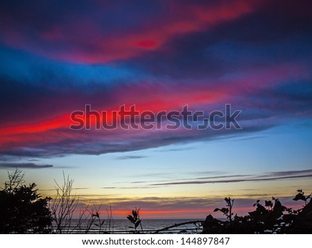 Colorful Sunset at Arcadia Beach on the Northern Oregon Coast USA - stock photo