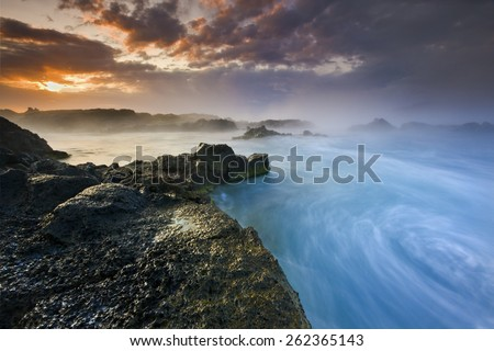 Colorful Sunset Beach Ocean Storm in South Iceland/ Whirlpool Sunset Beach - stock photo