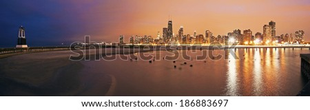 Colorful sunset in Chicago - panoramic view from the north side - stock photo