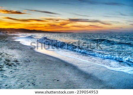 colorful sunset in Platamona beach, Italy. Processed for hdr tone mapping effect. - stock photo