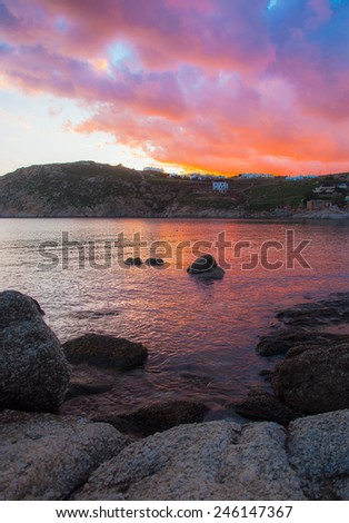 Colorful sunset in the sea bay on the island of Mykonos. Greece. - stock photo