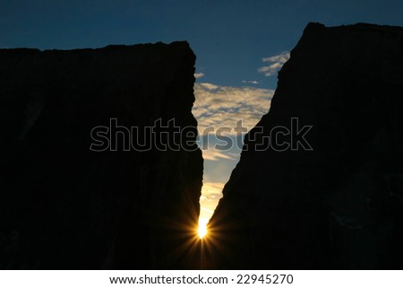colorful sunset in the valley of mountains - stock photo