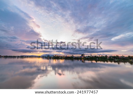 Colorful sunset on the Sarawak River from the Waterfront Promenade in Kuching, Borneo, Malaysia. - stock photo