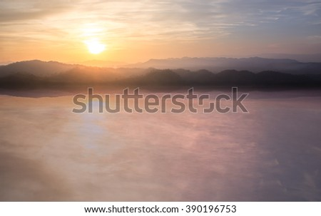 Colorful sunset on top of thailand mountain and lagoon - stock photo