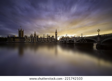 Colorful sunset over London City, Westminster bridge and Houses of Parliament - stock photo