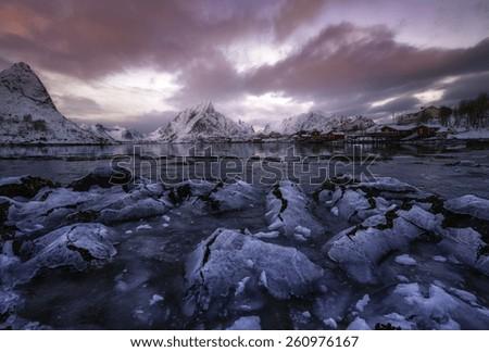 Colorful sunset over Reine, Lofoten islands, Norway - stock photo