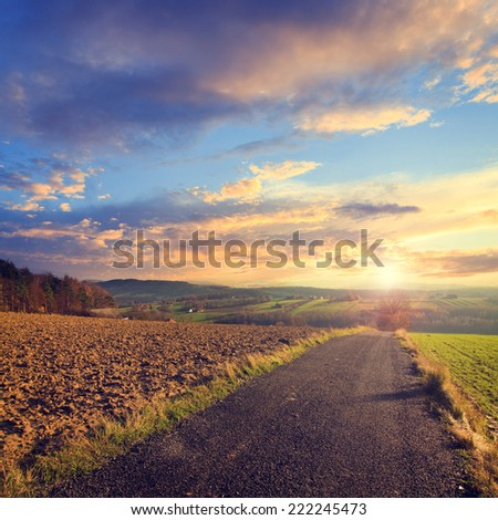 colorful sunset over road , vintage look - stock photo