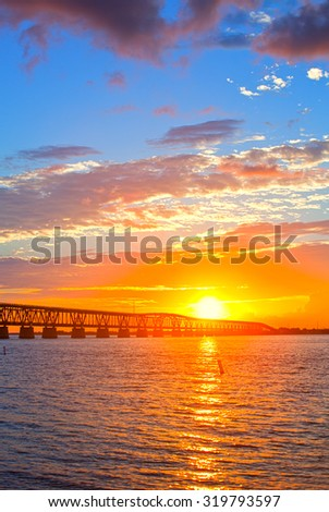 Colorful sunset over the old railroad bridge in Bahia Honda, Florida Keys - stock photo