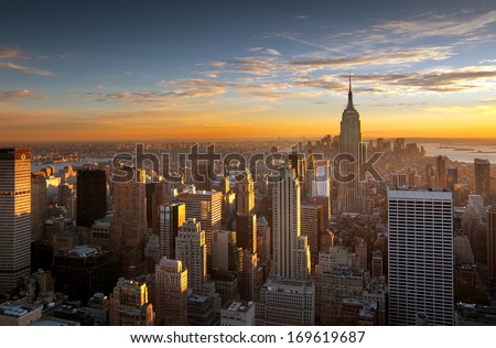 Colorful sunset over the skyline of New York city - stock photo
