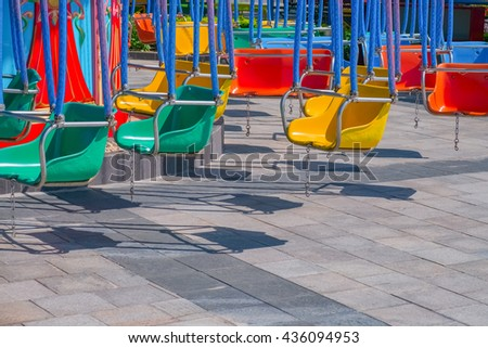Colorful swing ride at the amusement park - stock photo