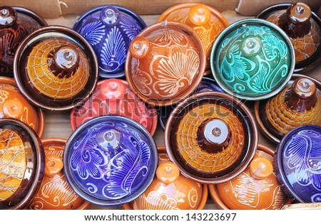 Colorful Tajines for sale in a market stall - stock photo
