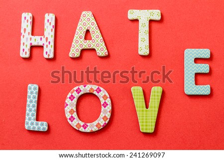 Colorful Text, Hate and Love with beautiful patterns on red background - stock photo