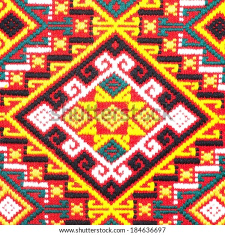 Colorful thai peruvian style rug surface close up. More of this motif & more textiles in my port. - stock photo