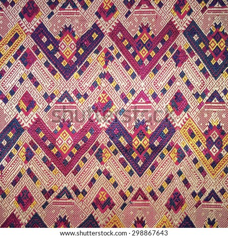 Colorful thai silk handcraft peruvian style rug surface close up More this motif & more textiles peruvian stripe beautiful background tapestry persian nomad detail pattern farabic fashionable textile - stock photo