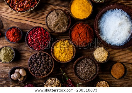 Colorful theme with spices on wooden table - stock photo