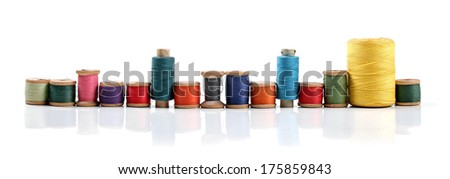 colorful thread bobbins isolated on white background - stock photo