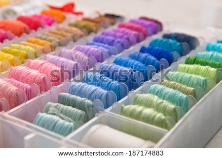 colorful threads in a storage - stock photo