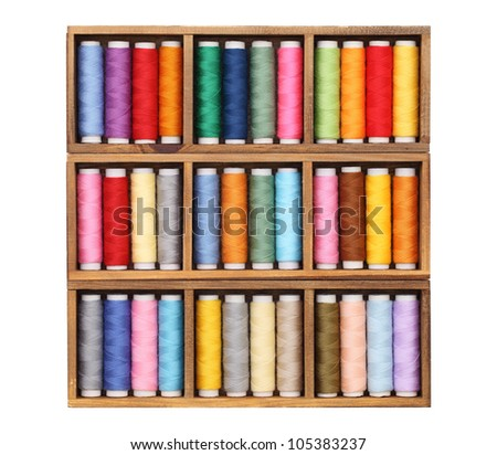 Colorful threads in wooden box - stock photo