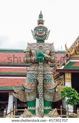 Colorful Three-Headed Guardian Statue at the Grand Palace and Wat Phra Kaew in Bangkok, Thailand - stock photo