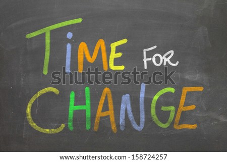"""Colorful """"Time For Change Hand"""" writing on the blackboard - stock photo"""