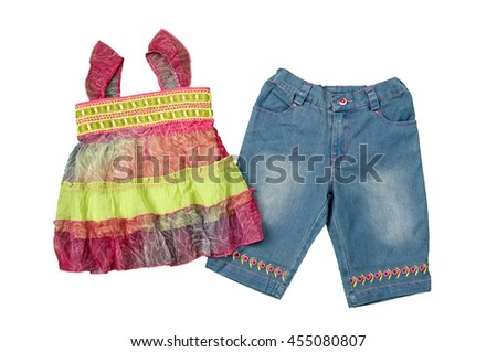 Colorful top and denim shorts for young girl - stock photo