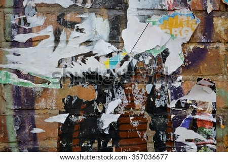 Colorful torn posters on grunge old walls as creative and abstract background - stock photo