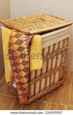 colorful towels in a basket - stock photo