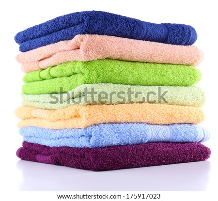 Colorful towels isolated on white - stock photo