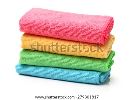 Colorful towels on white background  - stock photo