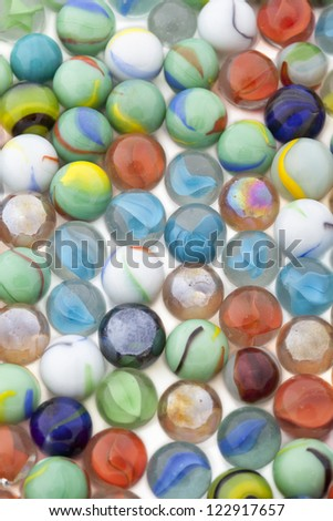 Colorful toy marbles collection in a background image - stock photo