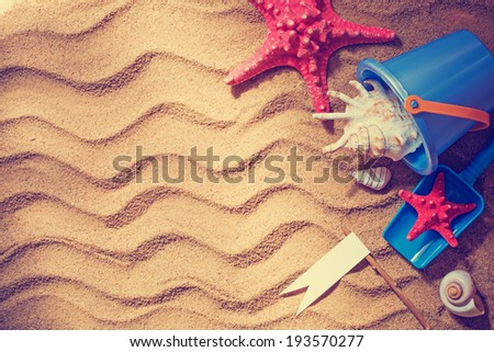 colorful toys for children sandboxes against the beach sand background/summer holidays background - stock photo