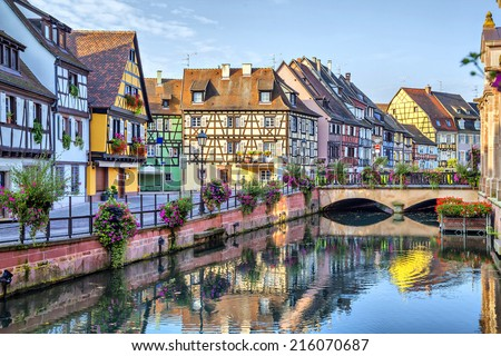 Colorful traditional french houses on the side of river Lauch in Petite Venise, Colmar, France - stock photo