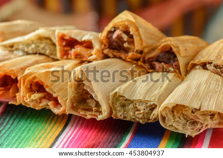 Colorful Traditional Mexican food dishes tamales - stock photo