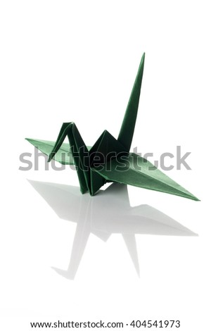 Colorful traditional origami bird (crane) made from green paper isolated on white background - stock photo