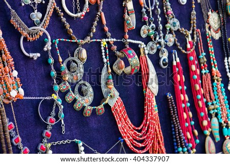 Colorful traditional uzbek beads and silver accessories in the bazaar - stock photo