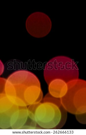 Colorful transparent circles abstract blur on black background. Lights at night. - stock photo