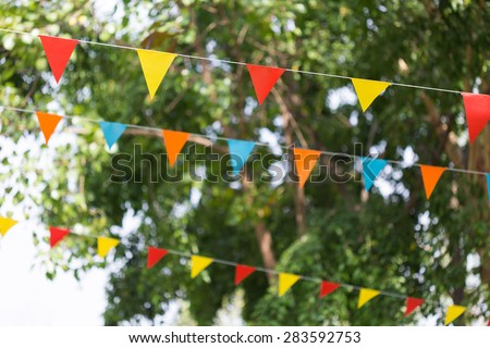 colorful triangular flags of decorated celebrate outdoor party - stock photo