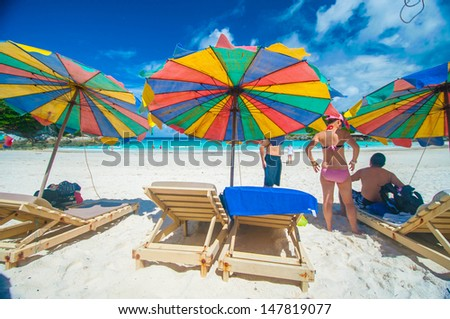 Colorful umbrella on the beach with tourist, Phuket Thailand - stock photo