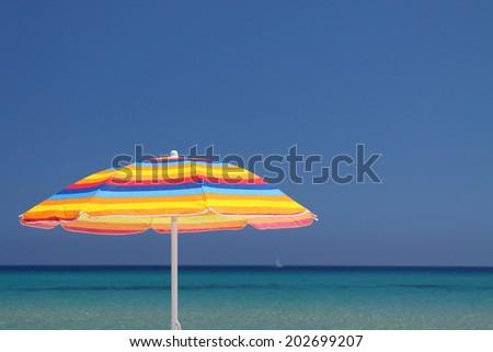 Colorful umbrella with sky - stock photo