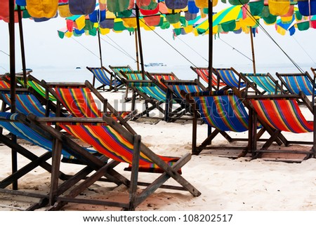 colorful umbrellas at beach - stock photo