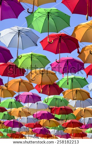 colorful umbrellas with blue sky in the background  - stock photo