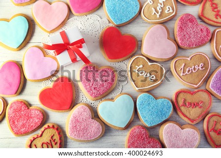 Colorful Valentine heart cookies on wooden table closeup - stock photo