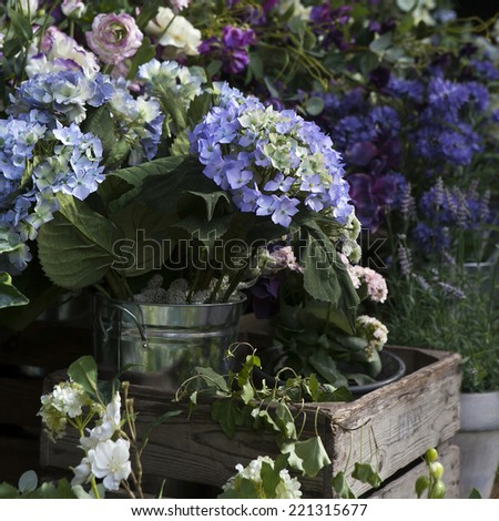 Colorful variety of artificial flowers - stock photo